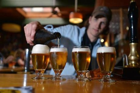 Brewer Ben Howe pours Enlightenment Ale at Cambridge Brewing Co.